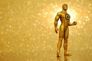 全身ゴールドタイツの男性。胸には二重の丸